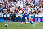 Yannick Ferreira Carrasco (l) of Atletico de Madrid battles for the ball with Toni Kroos of Real Madrid during their La Liga match between Real Madrid and Atletico de Madrid at the Santiago Bernabeu Stadium on 08 April 2017 in Madrid, Spain. Photo by Diego Gonzalez Souto / Power Sport Images