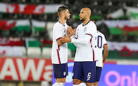 SWANSEA, WALES - NOVEMBER 12: Matt Miazga #3 and John Brooks #6 of the United States congratulate one another during a game between Wales and USMNT at Liberty Stadium on November 12, 2020 in Swansea, Wales.