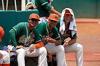 Greensboro Grasshoppers pitchers Manuel Rodriguez (19), Nestor Bautista (39), and Colton Hock (40) pose for a photo in the bullpen before a game against the Lakewood BlueClaws on June 10, 2018 at First National Bank Field in Greensboro, North Carolina.  Lakewood defeated Greensboro 2-0.  (Mike Janes/Four Seam Images)