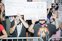 "Counterprotesters hold signs toward, flip-off, and angrily shout at those marching in the Straight Pride Parade in Boston, Massachusetts, on Sat., August 31, 2019. The parade was organized in reaction to LGBTQ Pride month activities by an organization called Super Happy Fun America.  The person's sign here reads ""Queer As In Fuck You."""