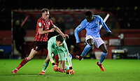 Lincoln City's Theo Archibald vies for possession with Manchester City U21's Claudio Gomes, right, and Manchester City U21's Cieran Slicker<br /> <br /> Photographer Chris Vaughan/CameraSport<br /> <br /> EFL Papa John's Trophy - Northern Section - Group E - Lincoln City v Manchester City U21 - Tuesday 17th November 2020 - LNER Stadium - Lincoln<br />  <br /> World Copyright © 2020 CameraSport. All rights reserved. 43 Linden Ave. Countesthorpe. Leicester. England. LE8 5PG - Tel: +44 (0) 116 277 4147 - admin@camerasport.com - www.camerasport.com