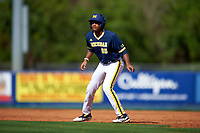 Michigan Wolverines right fielder Johnny Slater (25) leads off first base during the second game of a doubleheader against the Canisius College Golden Griffins on February 20, 2016 at Tradition Field in St. Lucie, Florida.  Michigan defeated Canisius 3-0.  (Mike Janes/Four Seam Images)