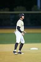 Shane Muntz (11) of the Wake Forest Demon Deacons takes his lead off of second base against the Liberty Flames at David F. Couch Ballpark on April 25, 2018 in  Winston-Salem, North Carolina.  The Demon Deacons defeated the Flames 8-7.  (Brian Westerholt/Four Seam Images)