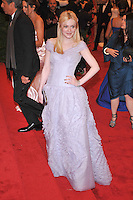 Dakota Fanning at the 'Schiaparelli And Prada: Impossible Conversations' Costume Institute Gala at the Metropolitan Museum of Art on May 7, 2012 in New York City. ©mpi03/MediaPunch Inc.