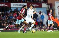 Sunday 07 December 2014<br /> Pictured: Ki Sung Yueng of Swansea (R) against Alex Song of West Ham (L)<br /> Re: Premier League West Ham United v Swansea City FC at Boleyn Ground, London, UK.