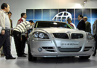 Visitors look at a Brilliance Zhonghua Junjie Diesel at the 2006 International Automotive Exhibition in Beijing, China.  .19 Nov 2006