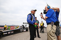 Mar 29, 2014; Las Vegas, NV, USA; NHRA top fuel driver J.R. Todd (left) is interviewed by ESPN during qualifying for the Summitracing.com Nationals at The Strip at Las Vegas Motor Speedway. Mandatory Credit: Mark J. Rebilas-