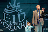 Mayor of London Ken Livingstone, with his daughter Mia, speaks at the first ever celebration in Trafalgar Square of the Muslim festival of Eid ul-fitr, which marks the end of Ramadan