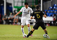 LAKE BUENA VISTA, FL - JULY 18: Joe Corona #15 of LA Galaxy is fouled by Dejan Jakovic #5 of LAFC after a pass during a game between Los Angeles Galaxy and Los Angeles FC at ESPN Wide World of Sports on July 18, 2020 in Lake Buena Vista, Florida.