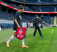 SOLNA, SWEDEN - APRIL 10: Carli Lloyd #10 of the USWNT enters the pitch before a game between Sweden and USWNT at Friends Arena on April 10, 2021 in Solna, Sweden.