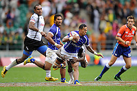 Tom Iosefo of Samoa is tackled during the iRB Marriott London Sevens at Twickenham on Saturday 11th May 2013 (Photo by Rob Munro)
