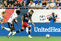 FOXBOROUGH, MA - AUGUST 18: Gustavo Bou #7 of New England Revolution dribbles down the wing as Chris Odoi-Atsem #3 of D.C. United closes during a game between D.C. United and New England Revolution at Gillette Stadium on August 18, 2021 in Foxborough, Massachusetts.