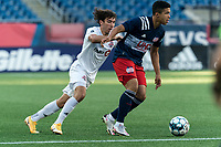 FOXBOROUGH, MA - JULY 9: Damian Rivera #72 of New England Revolution II dribbles as Kobe Franklin #58 of Toronto FC II defends during a game between Toronto FC II and New England Revolution II at Gillette Stadium on July 9, 2021 in Foxborough, Massachusetts.