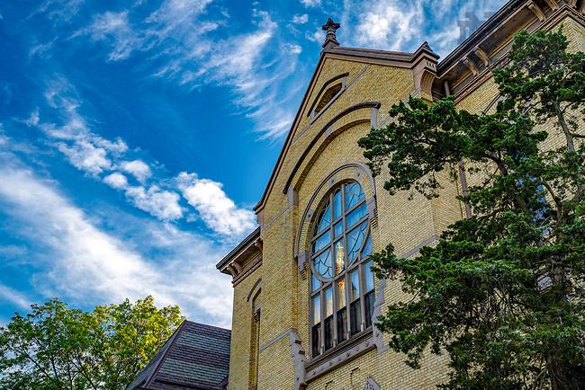 August 13, 2020; Dome reflected in west window of Washington Hall (Photo by Matt Cashore/University of Notre Dame)