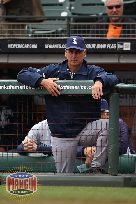 SAN FRANCISCO - SEPTEMBER 14:  Manager Bud Black #20 of the San Diego Padres watches from the dugout against the San Francisco Giants during the game at AT&T Park on September 14, 2011 in San Francisco, California. Photo by Brad Mangin