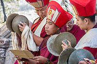 Nepal, Kathmandu, Swayambhunath.  Tibetan Buddhist Monks Playing Cymbals at a Ceremony.