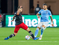 WASHINGTON, DC - APRIL 17: Junior Moreno #5 of D.C. United defends Valentin Castellanos #11 of New York City FC during a game between New York City FC and D.C. United at Audi Field on April 17, 2021 in Washington, DC.