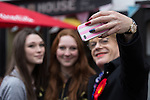 © Joel Goodman - 07973 332324 . 17/04/2015 . Chester , UK . People queue up to pose for selfies with EDDIE IZZARD (r) as he joins Labour candidate Chris Matheson , campaigning in the City of Chester constituency . Photo credit : Joel Goodman