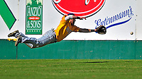 19 April 2009: University at Albany Great Danes' outfielder Dave West, a Senior from Toms River, NJ, makes a diving attempt to catch a drive by University of Vermont Catamounts outfielder Corey Moylan, a Sophomore from Glenview, IL, resulting in a triple at Historic Centennial Field in Burlington, Vermont. The Great Danes defeated the Catamounts 9-4 in the second game of a double-header. Sadly, the Catamounts are playing their last season of baseball, as the program has been marked for elimination due to budgetary constraints on the University. Mandatory Photo Credit: Ed Wolfstein Photo