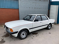 BNPS.co.uk (01202 558833)<br /> Pic: HampsonAuctions/BNPS<br /> <br /> Pictured: 1982 Ford Cortina 1.6 Crusader.<br /> <br /> Since the 1990s, Geoff Barlow, 46, has collected dozens of classic cars from an Escort Mexico replica to several types of Transit, Cortina, and Sierra.<br /> <br /> However, he still regrets selling the first car which inspired his passion, a 1980 Escort Mark 2 he bought from his sister in 1992.  <br /> <br /> Geoff's fascination with Fords gathered pace in the last decade and he 'lost control,' buying as many Fords as he came across and saving them from disrepair.