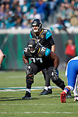 Jacksonville Jaguars Patrick Omameh (77) on the line as quarterback Blake Bortles (5) goes through the cadence during an NFL Wild-Card football game against the Buffalo Bills, Sunday, January 7, 2018, in Jacksonville, Fla.  (Mike Janes Photography)
