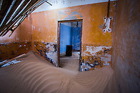 A room inside the ruined mining town of Kolmanskop in Namibia
