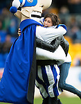 St Johnstone v Hibs...22.03.14    SPFL<br /> Olympic bronze medallists Eve Muirhead hugs supersaint<br /> Picture by Graeme Hart.<br /> Copyright Perthshire Picture Agency<br /> Tel: 01738 623350  Mobile: 07990 594431