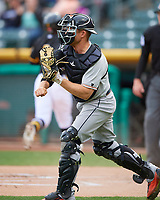 Max Stassi (13) of the Fresno Grizzlies on defense against the Salt Lake Bees in Pacific Coast League action at Smith's Ballpark on April 17, 2017 in Salt Lake City, Utah. The Bees defeated the Grizzlies 6-2. (Stephen Smith/Four Seam Images)
