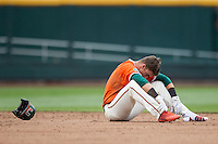 Miami Hurricanes outfielder Carl Chester (9) sits dejected on the ground after getting tagged out at second against the UC Santa Barbara Gauchos in Game 5 of the NCAA College World Series on June 20, 2016 at TD Ameritrade Park in Omaha, Nebraska. UC Santa Barbara defeated Miami  5-3. (Andrew Woolley/Four Seam Images)