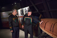 Quebec premier Philippe Couillard, left, looks at Konrad Sioui, Grand Chef of the Huron-Wendat nation, as he touches a canoe on display at the Hotel-Musee in Wendake, a Huron reserve enclave within Quebec City, Thursday July 17, 2014.<br /> <br /> PHOTO :  Francis Vachon - Agence Quebec Presse