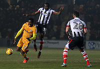 Mitchell Rose of Newport County is challenged by Tom Bolarinwa of Grimsby Town during the Sky Bet League Two match between Newport County and Grimsby Town at Rodney Parade, Newport, Wales, UK. Tuesday 14 February 2017