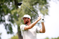 3rd July 2021, Detroit, MI, USA;   Chris Kirk hits his tee shot on the second hole on July 3, 2021 during the Rocket Mortgage Classic at the Detroit Golf Club in Detroit, Michigan.