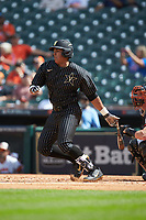 Jayson Gonzalez (99) of the Vanderbilt Commodores follows through on his swing against the Sam Houston State Bearkats in game one of the 2018 Shriners Hospitals for Children College Classic at Minute Maid Park on March 2, 2018 in Houston, Texas. The Bearkats walked-off the Commodores 7-6 in 10 innings.   (Brian Westerholt/Four Seam Images)