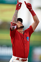 Philadelphia Phillies shortstop J.P. Crawford (12) points to the sky while crossing home plate after hitting a home run during a game against the Florida Fire Frogs while on rehab assignment with the Clearwater Threshers on June 1, 2018 at Spectrum Field in Clearwater, Florida.  Florida defeated Clearwater 12-10.  (Mike Janes/Four Seam Images)