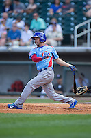 Elliot Soto (5) of the Tennessee Smokies follows through on his swing against the Birmingham Barons at Regions Field on May 3, 2015 in Birmingham, Alabama.  The Smokies defeated the Barons 3-0.  (Brian Westerholt/Four Seam Images)