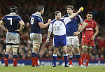 Referee Alain Rolland shows French number 8 Louis Picamoles the yellow card.<br /> RBS 6 Nations 2014<br /> Wales v France<br /> Millennium Stadium<br /> 21.02.14<br /> <br /> ©Steve Pope-SPORTINGWALES