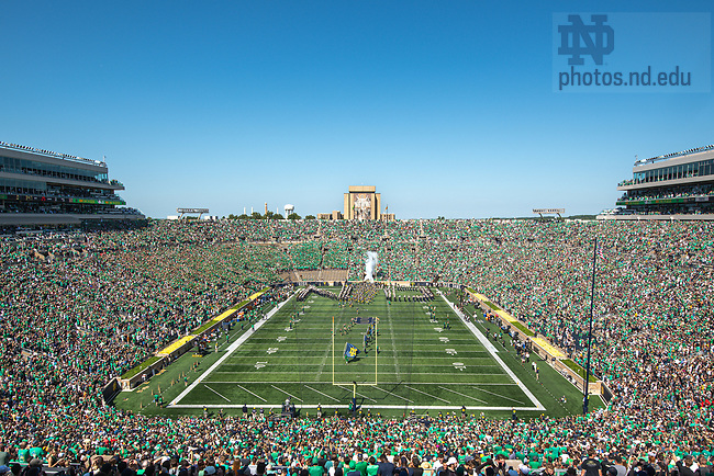 September 18, 2021; The Notre Dame cheerleaders lead the Notre Dame Fighting Irish onto the field before the game against the Purdue Boilermakers at Notre Dame Stadium. (photo by Matt Cashore/University of Notre Dame)