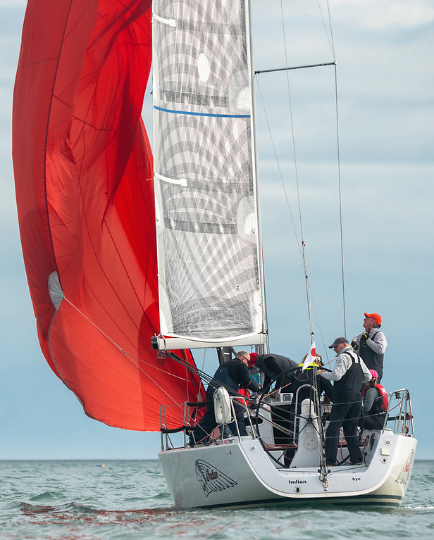 It was the sort of day when they got the racing finished just before the breeze failed – Simon Knowles' J/109 Indian making the best of it. Photo: Annraoi Blaney