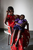 Former armed rebel, Tulsi alias Malti seen with her 3 year old son, Kosa in Bhairamgarh, Chhattisgarh, India. Photo: Sanjit Das/Panos for The Times