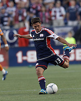 New England Revolution midfielder Ryan Guy (13) passes the ball. In a Major League Soccer (MLS) match, the New England Revolution tied Houston Dynamo, 2-2, at Gillette Stadium on May 19, 2012.