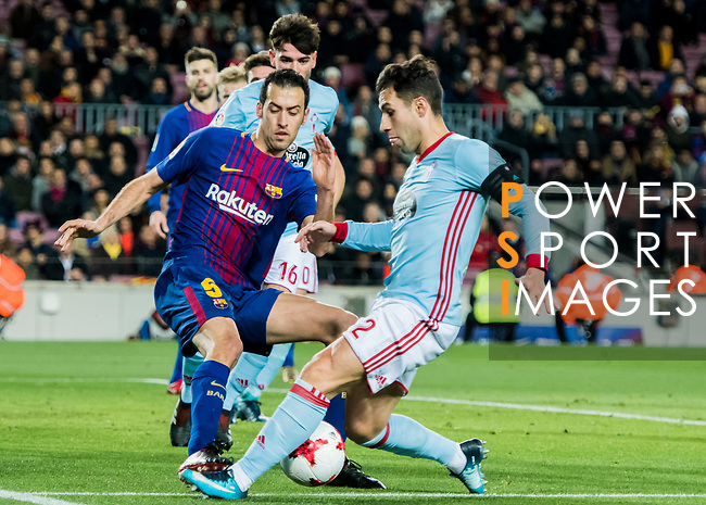 Sergio Busquets Burgos (L) of FC Barcelona fights for the ball with Hugo Mallo Novegil of RC Celta de Vigo during the Copa Del Rey 2017-18 Round of 16 (2nd leg) match between FC Barcelona and RC Celta de Vigo at Camp Nou on 11 January 2018 in Barcelona, Spain. Photo by Vicens Gimenez / Power Sport Images