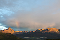 After a gray, rainy day, the clouds broke just before sunset.  We were fortunate to be in position to witness a rainbow over Mt. Sneffels.<br /> <br /> Canon EOS 5D, 70-200 f/2.8L lens