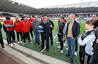 Pictured: Swansea City FC manager Brendan Rodgers (C) surrounded by staff, receiving the Barclays manager of the Month Award at the Liberty Stadium, south Wales. Tuesday 07 February 2012