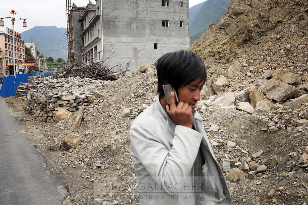 A man talking on his cellphone in the town of Heishui on the south-east edge of the Tibetan Plateau in Sichuan Province, western China.