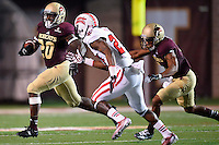 Texas State running back Terrence Franks (20) runs past Louisiana Lafayette safety T.J. Worthy (27) during first half of an NCAA football game, Tuesday, October 14, 2014 in San Marcos, Tex. Louisiana Lafayette leads 21-3 at the halftime. (Mo Khursheed/TFV Media via AP Images)
