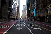New York, New York<br /> March 18, 2020<br /> 11:35 AM<br /> <br /> Manhattan under coronavirus pandemic. <br /> <br /> 42nd Street and 7th Avenue void of people and vehicles fearing spread of the virus.