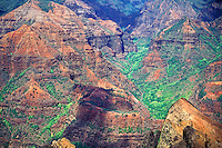 Dramatic view looking down into the spectacular multi-colored eroded cliffs of Waimea Canyon on the island of Kauai.