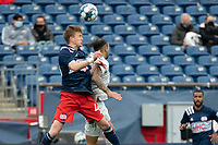 FOXBOROUGH, MA - APRIL 17: Sean O'Hearn #40 of New England Revolution II and Hernan Gonzalez #19 of Richmond Kickers compete for a high ball during a game between Richmond Kickers and Revolution II at Gillette Stadium on April 17, 2021 in Foxborough, Massachusetts.