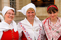 Close up of local people in traditional costume in dancing band in famous Old Town of tourist city of Prague in Czech Republic