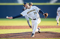 Michigan Wolverines pitcher Jack Bredeson (34) delivers a pitch to the plate against the Western Michigan Broncos on March 18, 2019 in the NCAA baseball game at Ray Fisher Stadium in Ann Arbor, Michigan. Michigan defeated Western Michigan 12-5. (Andrew Woolley/Four Seam Images)